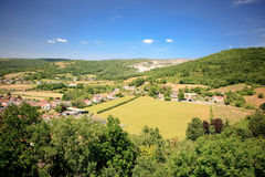 Cheddar Gorge landscape  view: cliffs and a town Stock Photo