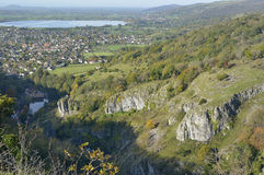 Cheddar Gorge. Viewed from Cheddar Cliffs, with Cheddar Reservoir, Brent Knoll & Crook Peak in the distance Stock Photography