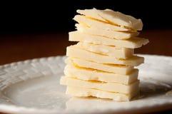 Cheddar-Käse-Scheiben Stockbild