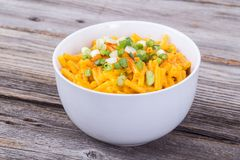 Mac and cheese bowl on rustic table. Cheddar mac and cheese bowl over rustic wooden table royalty free stock images