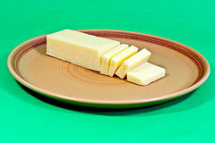 Cheddar cheese on plate Royalty Free Stock Image