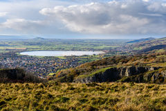 Cheddar Resevoir and the Somerset Levels from Cheddar Gorge. Bristol Water lake seen from high vantage point, with limestone cliffs of canyon in foreground Stock Photo