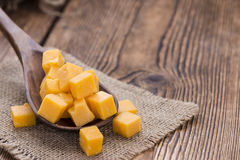 Cheddar on a Wooden Spoon Royalty Free Stock Photos