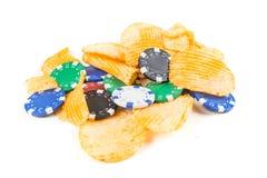 Cheddargräddfil- och pokerchiper arkivfoton