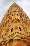 Chedi Buddhakhaya, built to mimic the Mahabodhi stupa of Bodhgay. A in India, is a symbol of Sangklaburi, Kanchanaburi, Thailand. It has hundreds of small metal Stock Photo