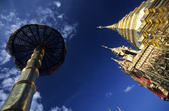 Chedi and parasol in a buddhist temple Royalty Free Stock Image