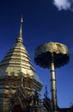 Chedi and parasol in a buddhist temple, Fine Art. Chedi and parasol covered over and over with gold in Wat Phra That Doi Suthep, a buddhist temple, near the stock images