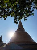 of Chedi on the thailand temple. Chedi and green leave on clear sky and sunlight Background. Religion of buddhist. Temple on Thailand Royalty Free Stock Photography
