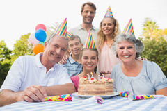 Cheeful family smiling at camera at birthday party Royalty Free Stock Images