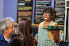 Cheeful Female Cafe Owner Stock Images