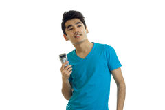 Cheeful young brunette man in blue t-shirt and trimmer in hand smiling. Isolated on white background Royalty Free Stock Photography