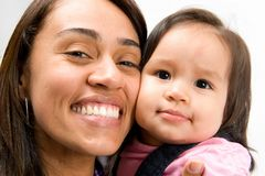 Cheek to cheek. Portrait of a woman and baby cheek to cheek Stock Photos