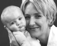 Cheek to cheek, mother and baby Stock Images