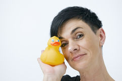 Cheek to cheek with rubber duck Royalty Free Stock Image