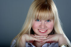 Cheeks. Wide smile of the blue-eyed girl Royalty Free Stock Photography