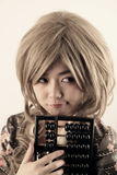 Cheeky Asian girl. Holding an abacus royalty free stock images
