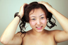 Cheeky Asian girl Stock Photos