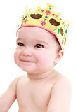 Cheeky baby. Wearing gold crown stock image