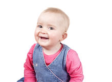 Cheeky baby girl  looking at camera smiling Royalty Free Stock Photos