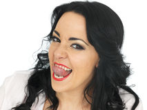 Cheeky Beautiful Young Hispanic Woman Pulling Silly Faces and Sticking Tongue Out Royalty Free Stock Images