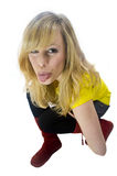 Cheeky Blonde Woman Sticking Tongue Out Royalty Free Stock Photo