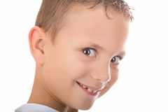 Cheeky boy. Portrait of a cheeky boy with a mile on his face. Isolated. White background Royalty Free Stock Photos