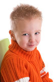 Cheeky boy. Young blond boy with a cheeky smile royalty free stock photography
