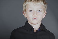 Cheeky boy with attitude pouting Stock Photos