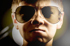 Cheeky boy in sunglasses. Boy in sunglasses serious look pert portrait Royalty Free Stock Photo