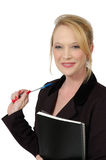 Cheeky Business woman. Business woman with blond hair on white background. Pen and report in her hand royalty free stock photos