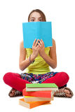 Cheeky Child Reading a Blue Book Stock Images