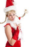Cheeky christmas girl. Cute young girl in christmas outfit on white background Royalty Free Stock Images