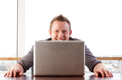 Cheeky computer user Royalty Free Stock Photos