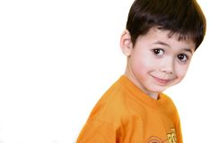 Cheeky eyes. A young boy with brown eyes appearing cheeky against white background Stock Photos