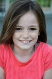 Cheeky girl. Cute cheeky teenager girl with long brown hair royalty free stock photography