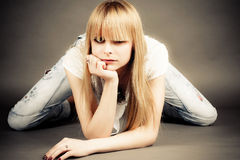 girl sits leaning on elbow Royalty Free Stock Photos