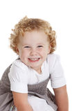 Cheeky grin. Adorably young girl with a cheeky grin on her face Stock Photography