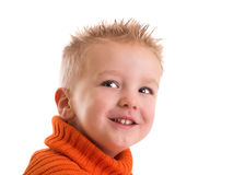 Cheeky grin. Cute two year old boy with a cheeky grin on his face stock images