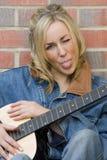 Cheeky Guitarist Stock Image