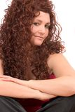 Cheeky look. Attractive woman with long curly wig Stock Images