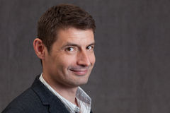 Cheeky looking man in his forties Royalty Free Stock Photo