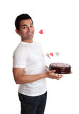 Cheeky man with a love heart cake Royalty Free Stock Photos