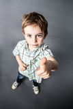 Cheeky OK for mischievous little boy expressing his child approval Royalty Free Stock Photography