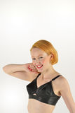 Cheeky red head in retro  bra Stock Photography