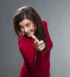 Cheeky 30s woman enjoying gesturing for fun Stock Image