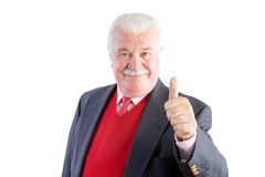 Cheeky senior gives a thumbs up and smiles Stock Images