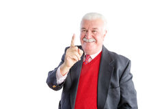Cheeky senior wearing a business suit smiles Royalty Free Stock Images