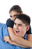 Cheeky siblings Stock Images