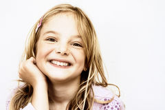 Cheeky smile. A cute little girl with an adorable and mischievous smile Royalty Free Stock Image
