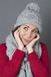 Cheeky teenager smiling in thinking about winter seasonal greetings Royalty Free Stock Photo